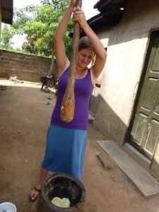 Me pounding a yam to make yam pile one Saturday afternoon.